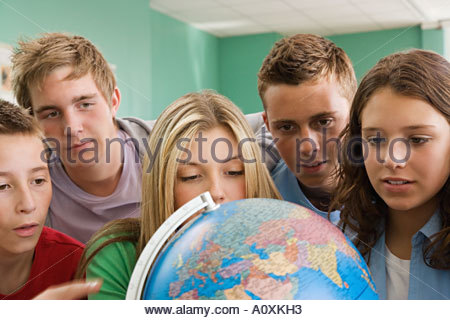 School students looking at a globe - Stock Photo