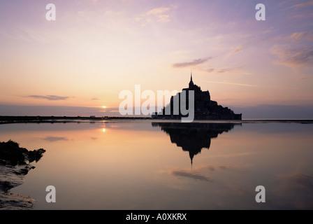 Mont Saint Michel at sunset UNESCO World Heritage Site La Manche region Basse Normandie Normandy France Europe - Stock Photo