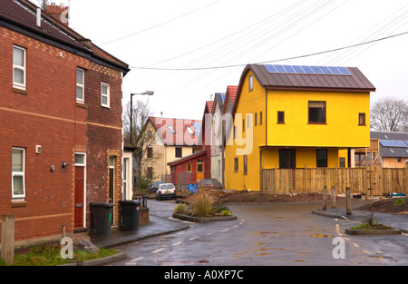 Self build ECO homes under construction at the Ashley Vale site in Bristol juxtaposed against Victorian terraced - Stock Photo