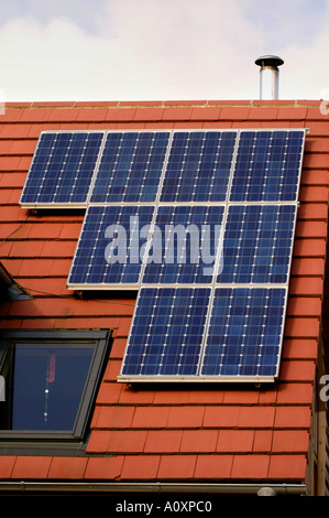 Self build ECO homes under construction at the Ashley Vale site in Bristol England UK GB solar panels on red tile - Stock Photo