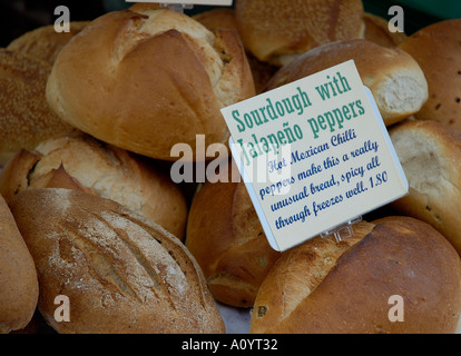 Sourdough bread with jalepeno peppers for sale on market stall England United Kingdom UK United Kingdom England - Stock Photo