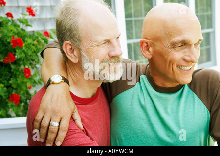 Middle-aged gay couple hugging - Stock Photo