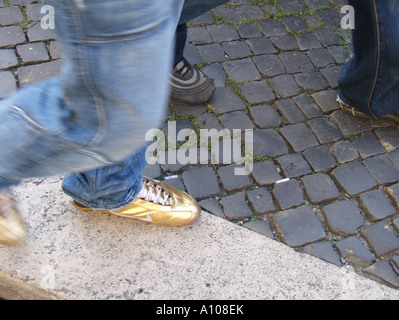 person wearing golden sports shoes - Stock Photo
