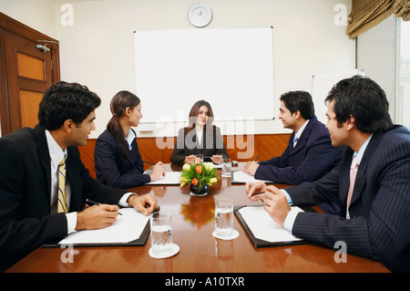 Five business executives at a meeting in a conference room - Stock Photo