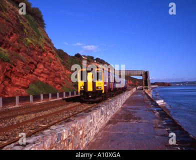 Seafront and main railway line at Dawlish on the South coast of Devon - Stock Photo