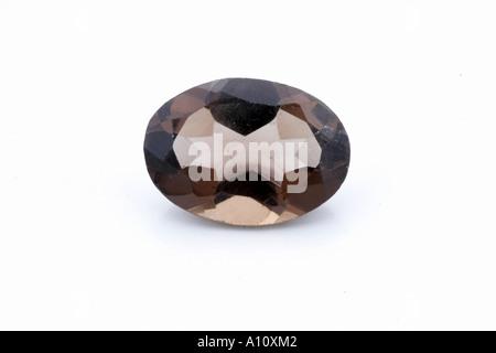 UGA75742 Smokey Topaz Semi Precious Stone on white background - Stock Photo