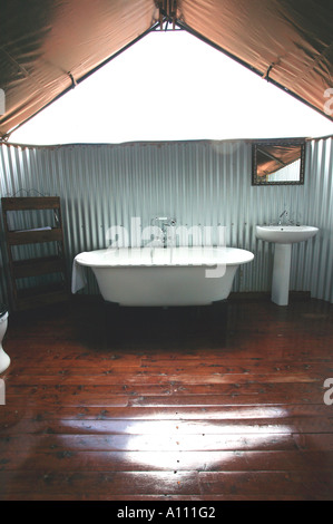 Luxury bathroom in tent of Gunya Titjikala safari resort near Alice Springs Red Centre Central Australia - Stock Photo