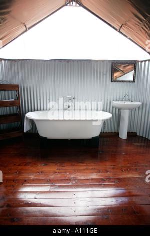 Luxury bathroom in tent of Gunya Titjikala a luxury aboriginal safari resort near Alice Springs Red Centre Central - Stock Photo