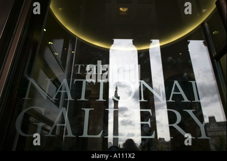 Reflection of Nelson's Column in the portico entrance doors of the National Gallery, Trafalgar Square, London, England, - Stock Photo