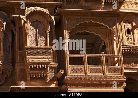UGA75920 Zarokhas windows balconies Patwon ki Haveli Jaisalmer Rajasthan India - Stock Photo