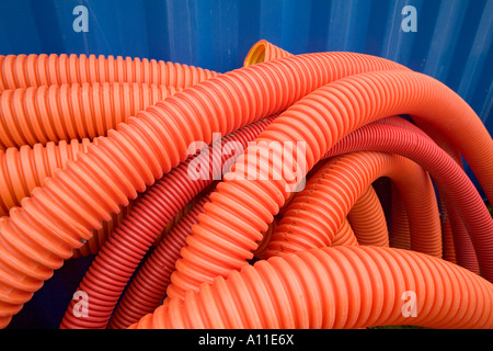 Orange electrical wire insulation rolls on a buiding site (Allier - France). Tuyaux oranges sur un chantier (Allier - Stock Photo