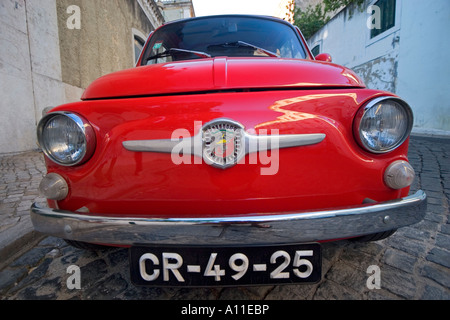 The red FIAT ABARTH 595 (Lisbon - Portugal). FIAT 500 rouge en version ABARTH 595 (Lisbonne - Portugal). - Stock Photo