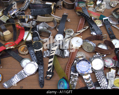 selection of watches for sale on market stall - Stock Photo