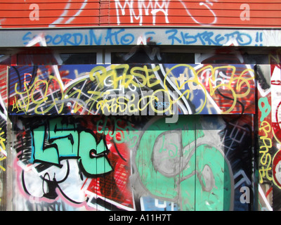 name plate board covered with graffiti in train station in rome - Stock Photo