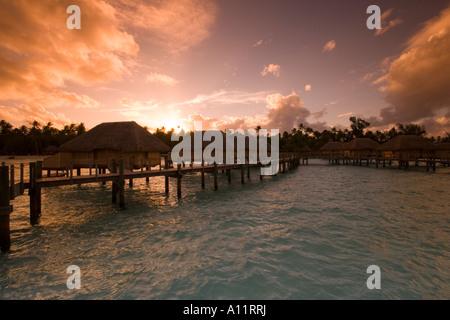 Overwater Bungalows, Sunset, Pearl Beach Resort , Bora Bora Lagoon, French Polynesia, - Stock Photo