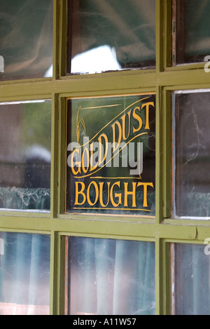 Gold dust bought old western sign in a shop window at Old Tucson Studios - Stock Photo