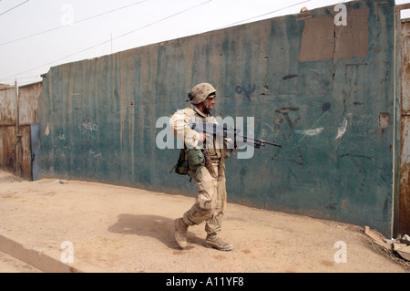 9 April 2003 Bagdad Iraq Marines of the 3rd Battalion 4th Marines search houses as they enter the center of bagdad - Stock Photo
