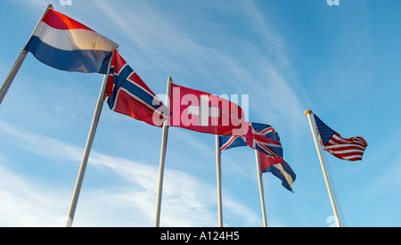 Flags in the early morning breeze Nice France - Stock Photo