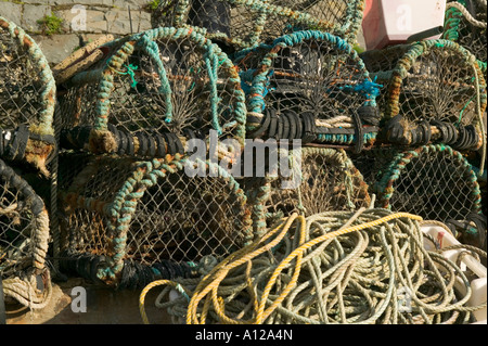 Lobster pots on the harbour side New Quay Ceredigion Wales - Stock Photo