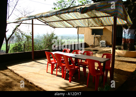 RSC75129 Road side budget restaurant with red chairs national highway Maharashtra India - Stock Photo