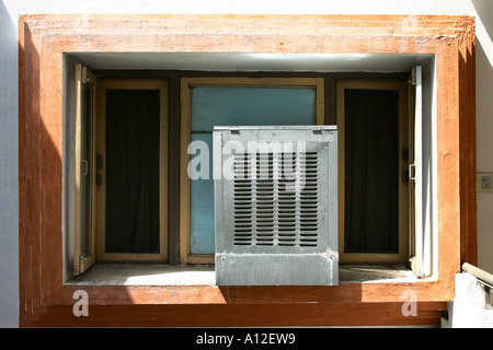 RSC75159 Indian Air conditioner known as cooler installed on window of hotel room Ujjain Madhya Pradesh India - Stock Photo