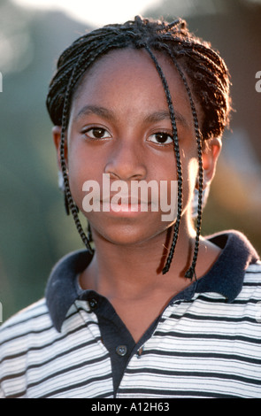 12 years French-African origin Black Female Teenager portrait Single people 'Looking at Camera' Youth Ethnicity - Stock Photo