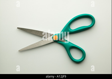Open scissors on white background - Stock Photo