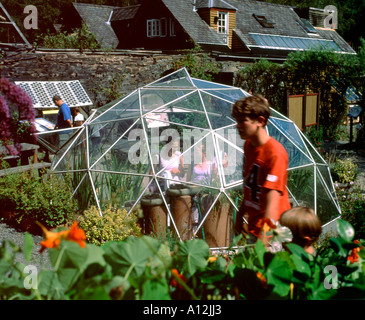 Visitors in the vegetable garden in the grounds of the Centre for Alternative Technology at  Machynlleth in Powys - Stock Photo