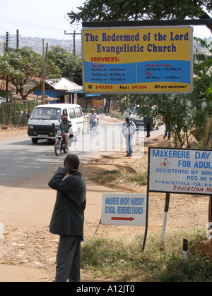 Sign for The Redeemed of the Lord Evangelistic Church among others on a Kampala road, Uganda - Stock Photo