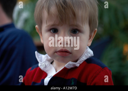 Happy toddler looking at camera tight model released and property released image mother Model released and Property - Stock Photo