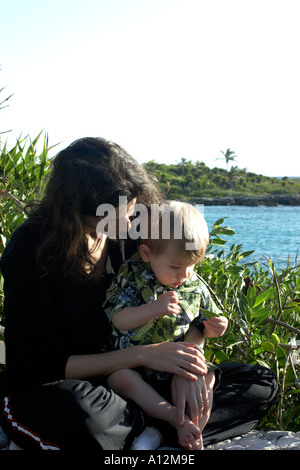 Woman holding boy on vacation model released beach ecology cancun akumal mexico ecosystem environment mother Model - Stock Photo