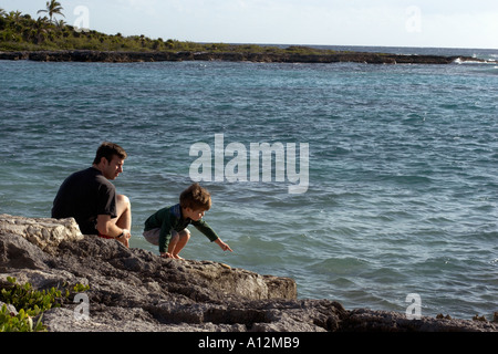 Boy and father at beach model released beach ecology cancun akumal mexico ecosystem environment habitat mother Model - Stock Photo