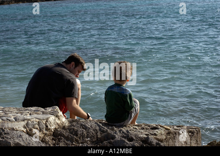 Boy and father at beach model released beach ecology cancun akumal mexico ecosystem environment environmentalism - Stock Photo