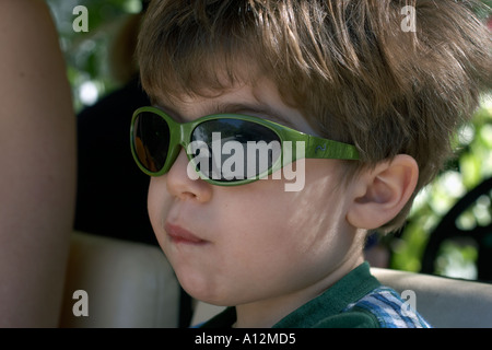 Boy in golf cart at beach model released beach ecology cancun akumal mexico ecosystem sunglasses green environment - Stock Photo