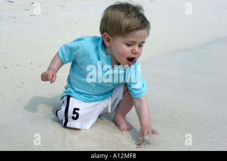 Young boys play on beach model released beach ecology cancun akumal mexico ecosystem environment environmentalism - Stock Photo