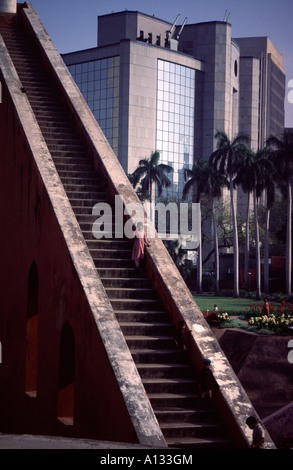 A young girl on the steps of a giant astronomical measuring device at Janta Mantar, New Delhi, India - Stock Photo