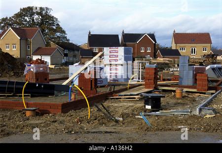 Houses under construction at Rendlesham Heath near Woodbridge on the former UASF Bentwaters base in Suffolk, UK. - Stock Photo