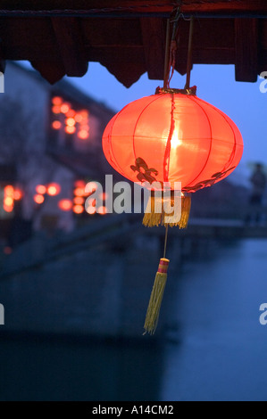 Chinese red lantern glowing in the night, photo taken in Xitang, a water town near Shanghai, China - Stock Photo