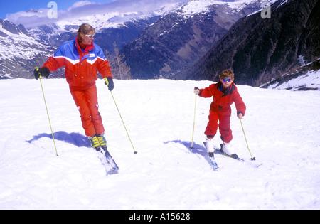 Ski School lesson France instructor female and child - Stock Photo