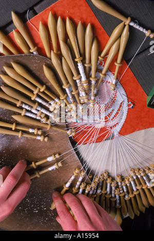 Close up of hands and bobbins for lace making at Le Puy in the Auvergne France A Woolfitt - Stock Photo