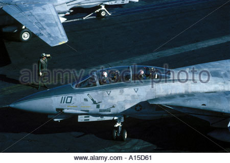 F14 Pilots prepare for take off on the flight deck of the USS Nimitz - Stock Photo