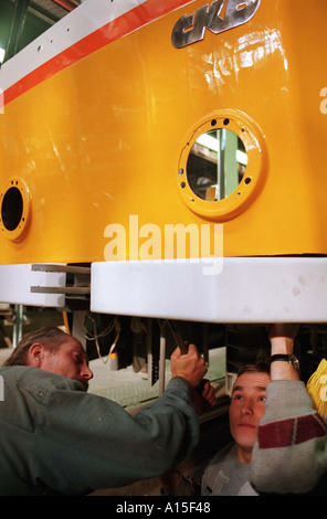 Workers prepare a tram at the CKD tram and train factory in Prague Monday October 25 1999 in the Czech Republic. - Stock Photo