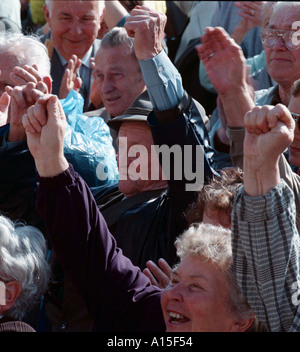 Supporters of the Communist party cheer during a rally for on Tuesday June 16 1998 in Prague. Elections will take - Stock Photo