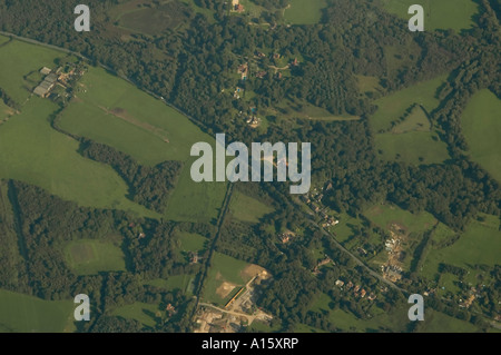 Horizontal aerial view from an aeroplane of the patterned countryside below. - Stock Photo