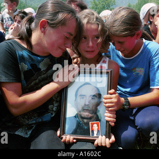 Kosovar Albanians mourn their fathers' death Sunday July 25 1999 in Ljubenica Kosovo during a memorial service for - Stock Photo