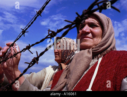 Ethnic Albanian refugees from Kosovo wait for relatives to arrive at the Stenkovec camp near Skopje Macedonia Monday - Stock Photo