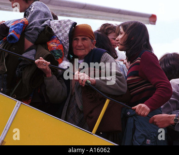 Ethnic Albanian refugees from Kosovo board a plane flying to Turkey in Skopje  Macedonia Monday April 12 1999. - Stock Photo