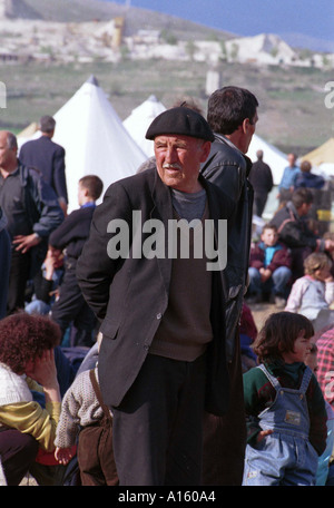 Newly arrived ethnic Albanian refugees from Kosovo wait for tents at the Stenkovec camp near Skopje Macedonia Monday - Stock Photo
