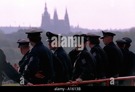 Police watch protesters preparing to march through the streets of central Prague in the Czech Republic September - Stock Photo