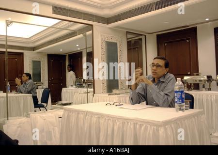 Jagdish Agarwal Founder of Dinodia Photo Library conducting annual photographers meeting in Bombay Mumbai India - Stock Photo